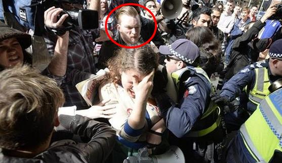 Protester at Peter Doherty Institute wanted for assaulting police