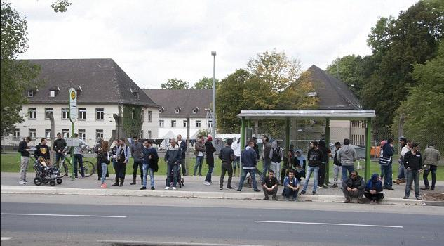 Muslim migrants at Giessen bus stop, Germany
