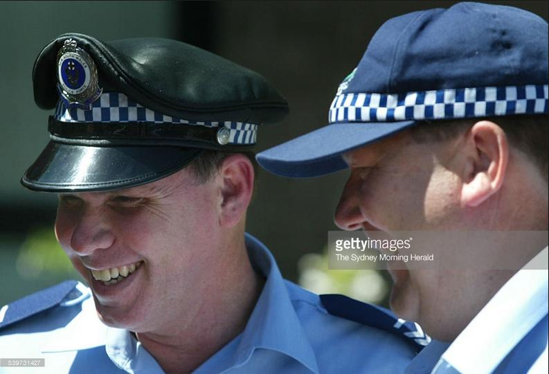 Sergeant Craig Campbell doing police work