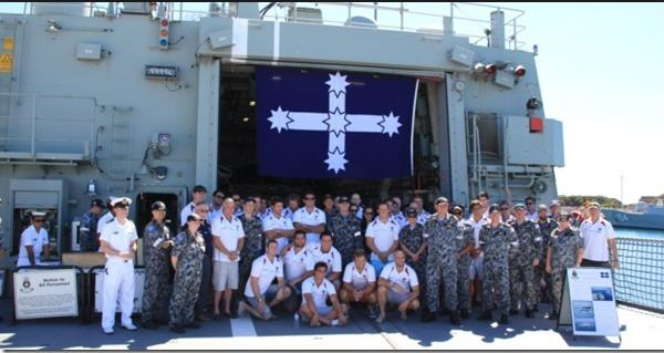 HMAS Ballarat flying the Eureka Flag